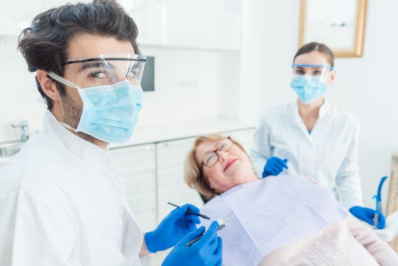 Dentist in Sparta wearing PPE